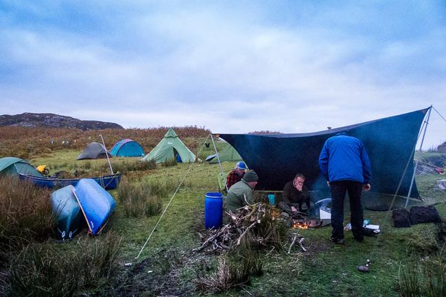 Campfire under a tarp