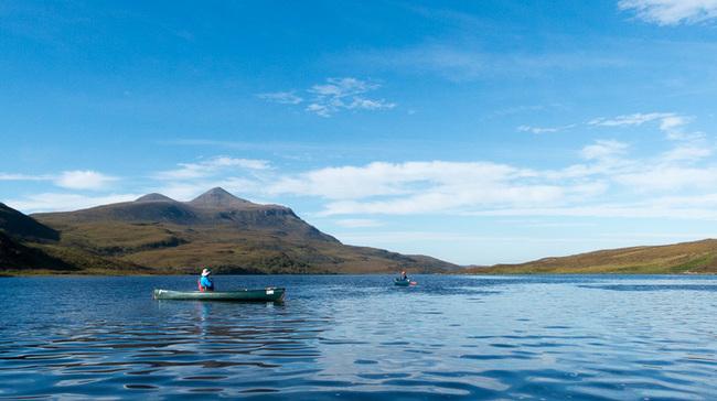Canoeing down Loch Veyatie