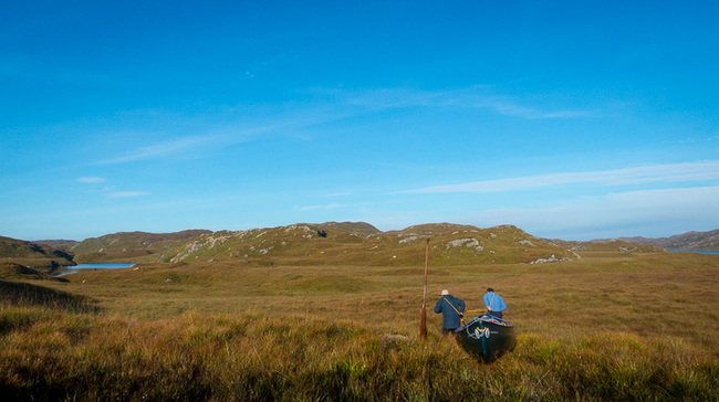 Dragging a canoe over the heather