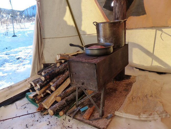 Wood burning stove in a tent